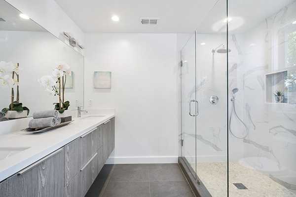 A modern white bathroom with ash wood finish cabinet