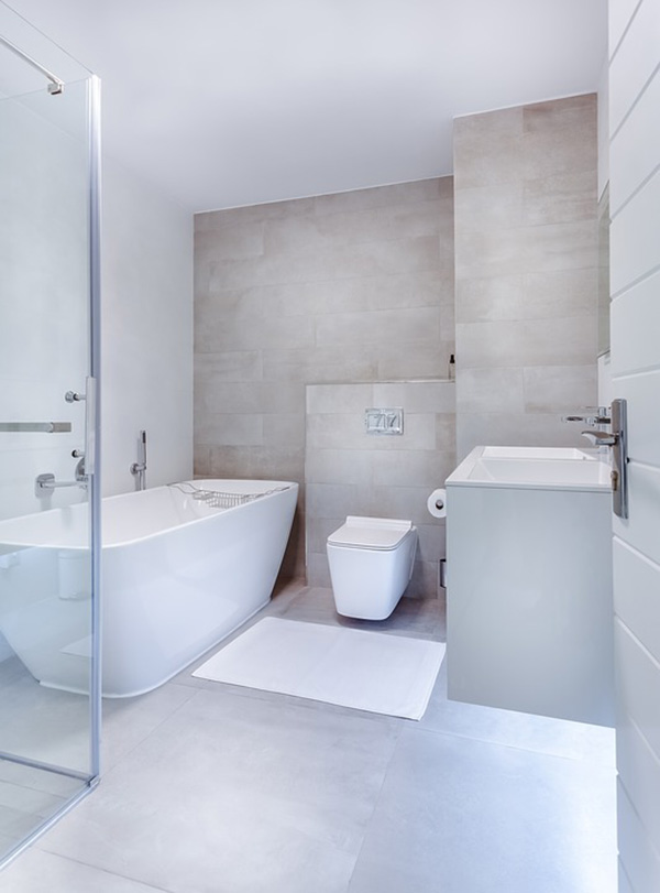 A white bathroom with cream-toned tile