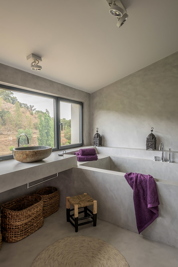 A modern bathroom in warm and cozy microcement
