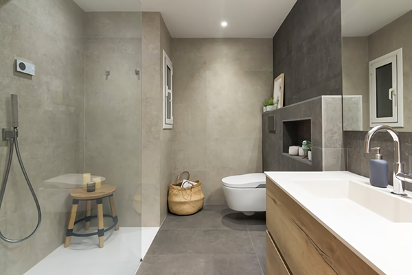 A bathroom finished in warm and cozy cement