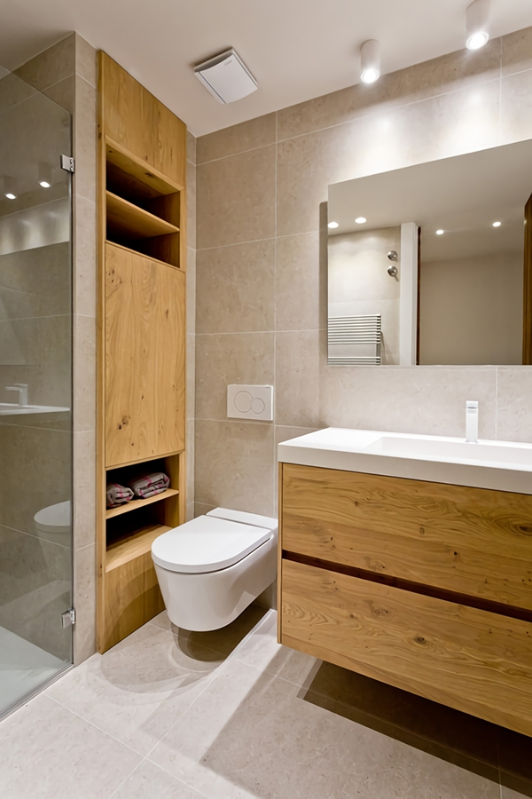 A modern bathroom in gray and wood tones