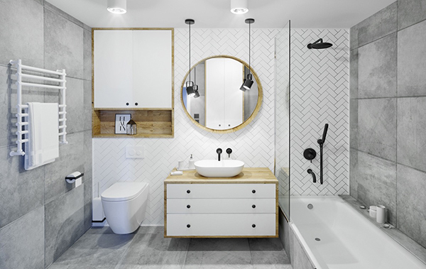 A modern gray and white bathroom with wood accents
