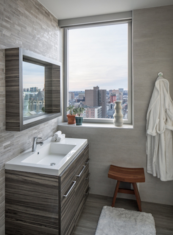 A bathroom in gray tones with good lighting