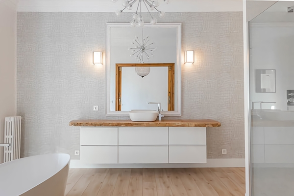 A modern bathroom in gray tones but warm and cozy