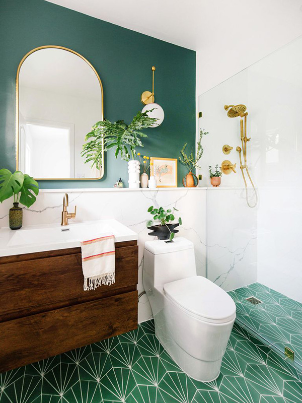 A small modern bathroom in green and gold tones