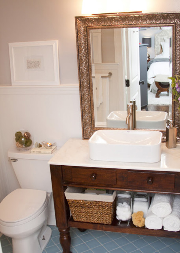 A small bathroom with the mirror on the counter