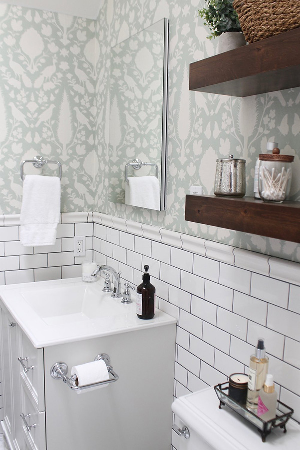 A small bathroom with wallpaper