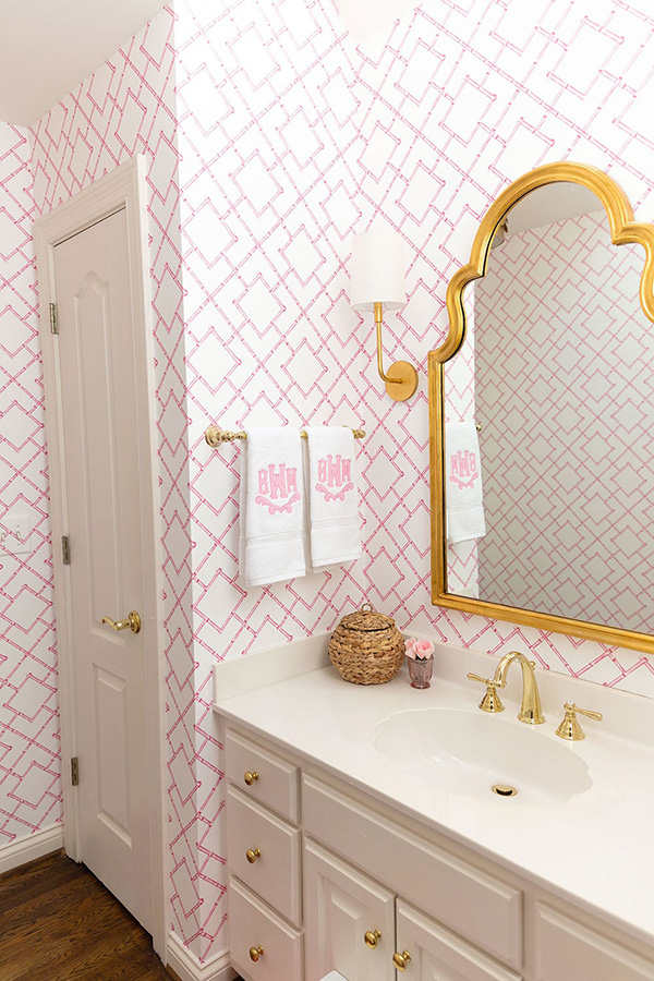 A small bathroom in pink and gold