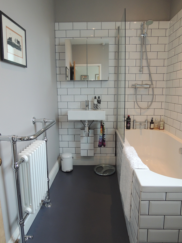 A small bathroom in white and gray tones in vintage style