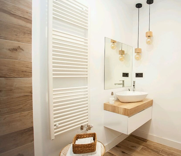 A small bathroom in white and wood