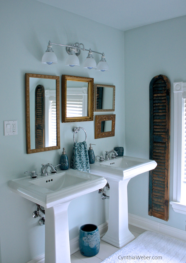 A vintage bathroom with antique framed mirrors