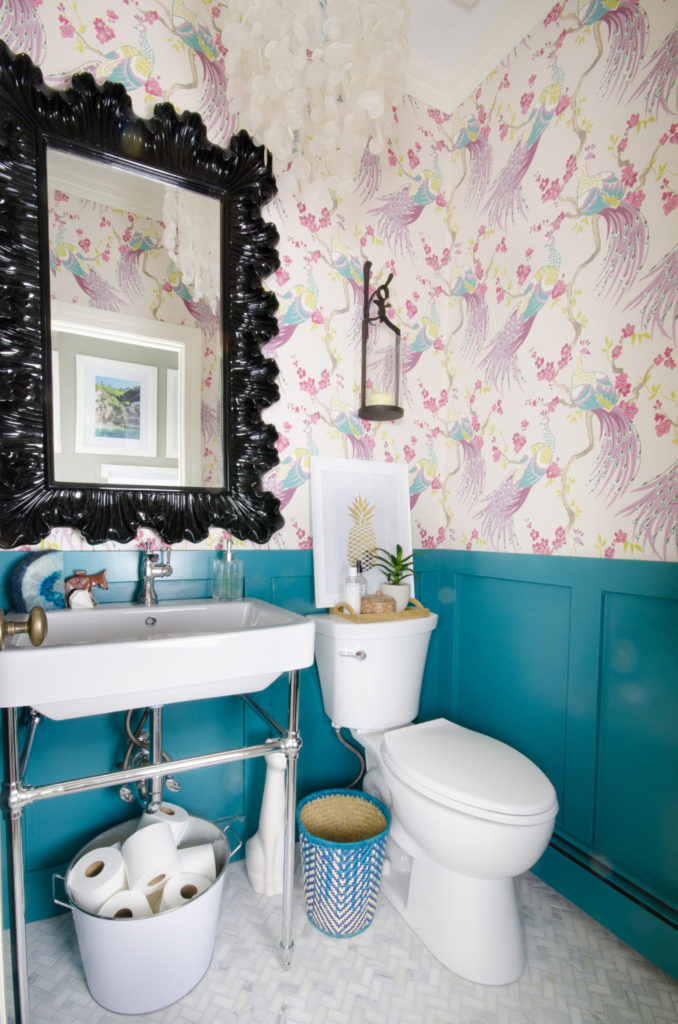 A bathroom decorated with wallpaper