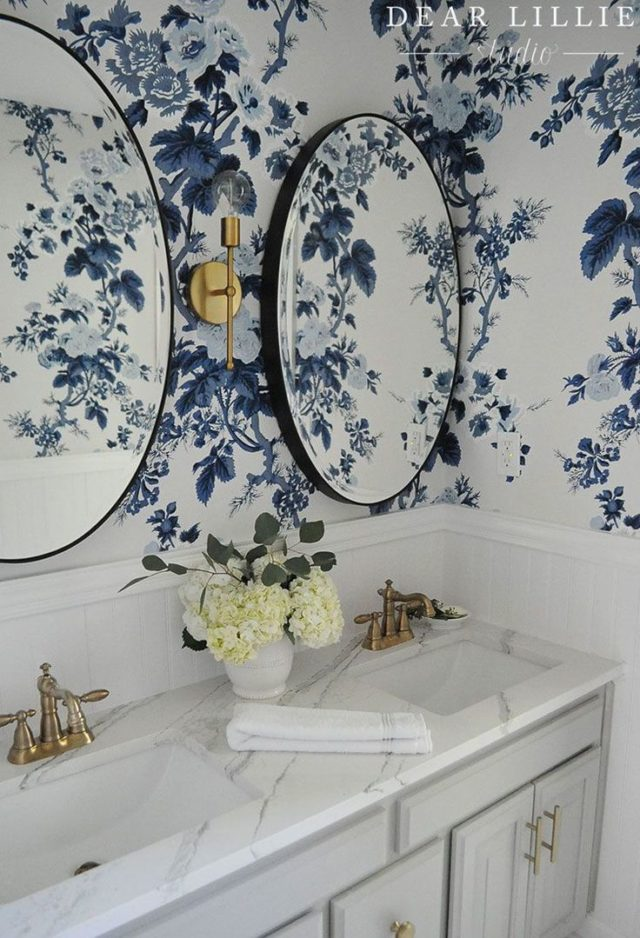 A bathroom with wallpaper