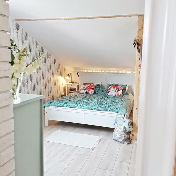 Attic bedroom with low walls