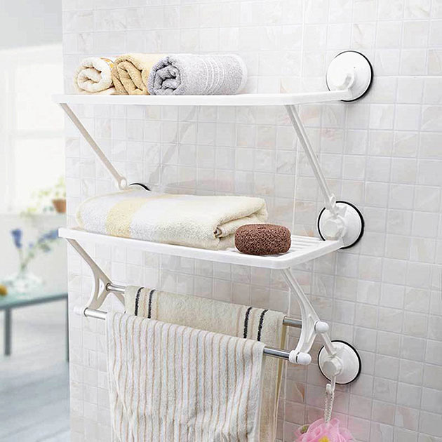 Shelf and towel rack with suction cups for the bathroom