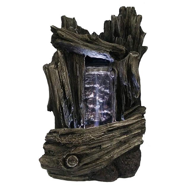 Una fuente tipo Zen imitación a madera con luces LED y cascada de agua