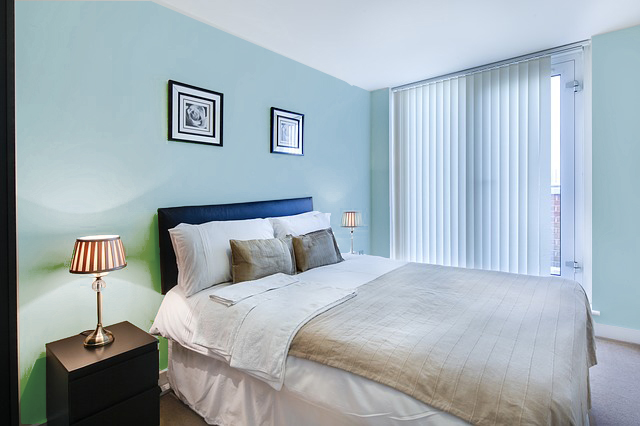 Bedroom painted in cool colors