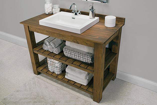 Un mueble de baño de madera fabricado a mano.