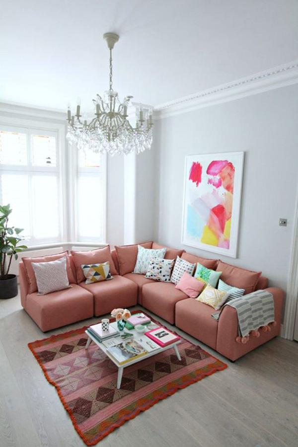 Sala de estar o salita pintada y decorada en color gris y rosa
