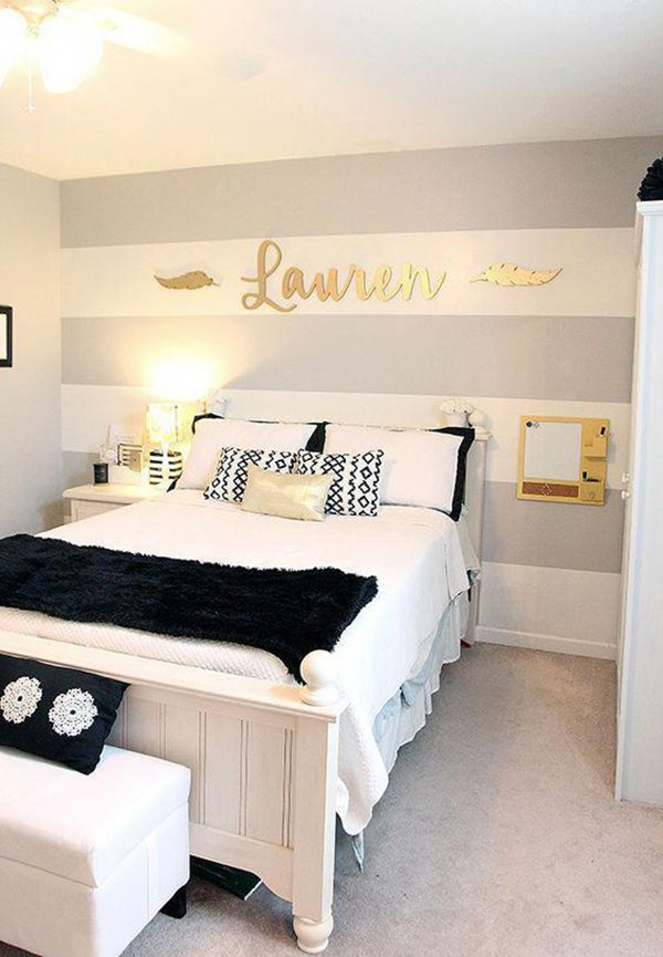 Bedroom painted in horizontal stripes to make it visually larger