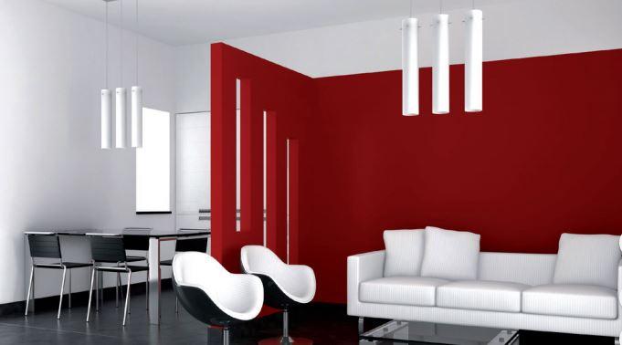 Un salón pintado de rojo con muebles blancos