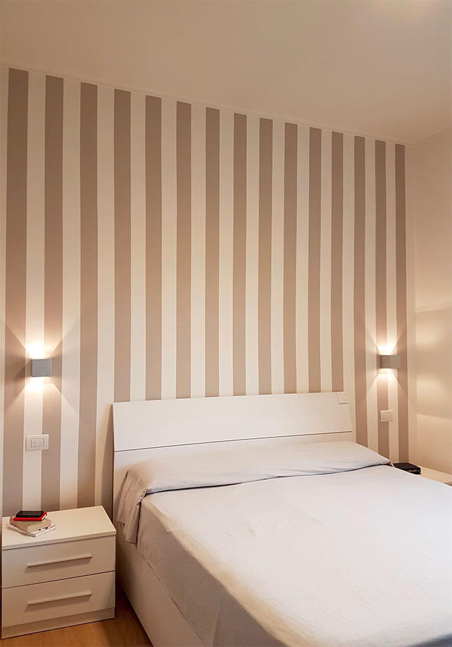 Paint vertical stripes to make the bedroom taller